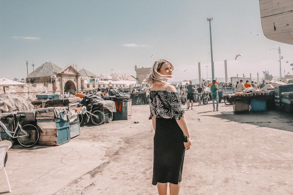 essaouira morocco port fish girl