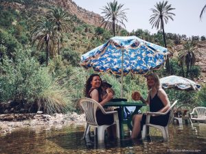 paradise valley morocco river palm trees cafe fish