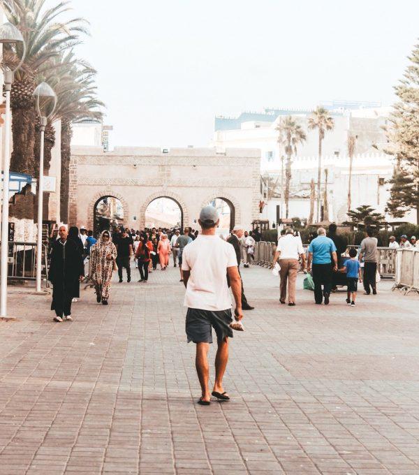essaouira morocco street people palm trees